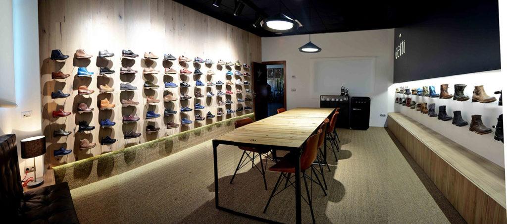 Diseño de Showroom de calzado estilo industrial