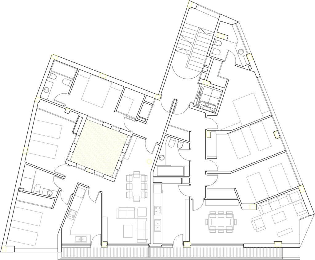 Plano del proyecto de construcción de edificio viviendas con fachadas a dos orientaciones