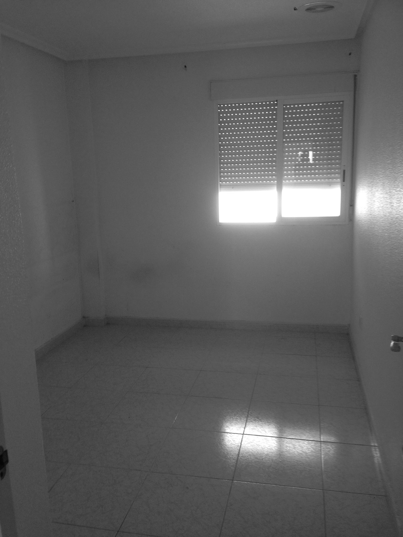 Estado previo en reforma de vivienda en salón, comedor y cocina para conseguir iluminación natural